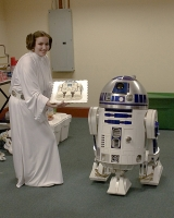 Princess Leia presented R2 with his cake.